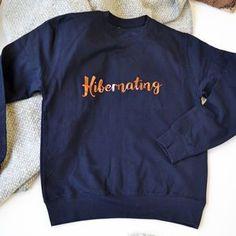 Hibernating Copper Sweatshirt. Shop Christmas Jumpers now.