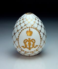 A Russian Imperial Presentation Porcelain Easter Egg 1917   painted with a gold cypher of empress Maria Feodorovna (mother of tsar Nicholas II) - interlaced ribbon formed Cyrillic letters  ' М '  and  ' Ф ' beneath Imperial crown.    Made at the Imperial porcelain factory in St Petersburg.