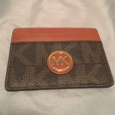 Michael Kors Monogram Leather Card Case Holder This Michael Kors Monogram Card Case Holder is in great condition!! It features leather slip pockets and monogram pvc pockets with a gold medallion in the middle. Super slim and fashionable! MICHAEL Michael Kors Accessories Watches