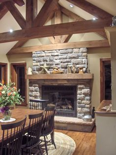 Interesting Interior Home Design with Lowes FirePlace: Traditional Dining Room Design With Lowes Fireplace And Mantle Shelf Plus Sloped Ceiling With Faux Ceiling Beams And Ceiling Lights Also Mid Century Dining Chairs Ledge Stone Fireplace, Stone Fireplace Designs, Stacked Stone Fireplaces, Painted Brick Fireplaces, Diy Fireplace, Modern Fireplace, Propane Fireplace, Wooden Dining Tables, Dining Table Chairs