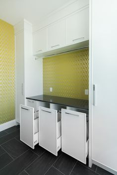 Laundry room idea. Whimsical wallpaper adds an exciting flare to this hang to dry area.