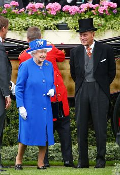 Sunshine: Her Majesty was resplendent in a royal blue ensemble by couturier Karl Ludwig and hat by Angela Kelly