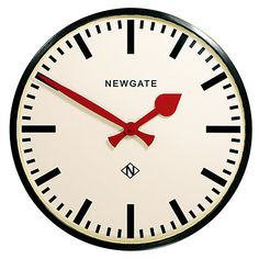 The Putney Large Black Station Wall Clock A large railway station wall clock with a gloss black finish. A deep straight-cut metal case and a bold marker dial contrast with red metal hands to make the Putney one of Newgate's most iconic designs.