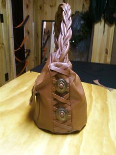 Side view of brown leather purse.
