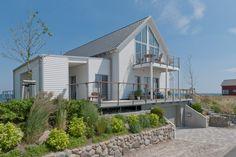 Design Ferienhaus mit Landhaus Still von Baufritz