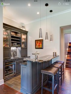 Chic living room bar features dark stained shaker cabinets paired ...
