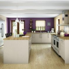 Somerton Sage kitchen by Magnet. Purple feature wall