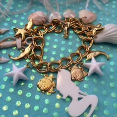 Hey, I found this really awesome Etsy listing at https://www.etsy.com/listing/180908976/under-the-sea-charm-bracelet