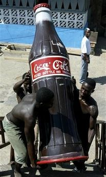 Look at this bizarre coca-cola shaped coffin! At JC Walwyn we supply a more traditional range of coffins and caskets.