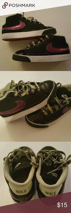 Nike sneakers Size 10. Good condition. Black, purple, and green colors Nike Shoes Sneakers