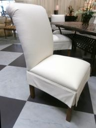 """Price: $594.99 Item #: 137719 A set of 4 dining chairs from Ethan Allen upholstered in white with an embroidered """"E"""" on the back, a pleated skirt runs around the base, and all rests on medium brown legs. This set measures21W * 30D * 39H."""