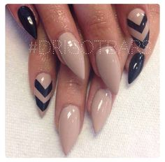 Nude stiletto nails with black chevron designs