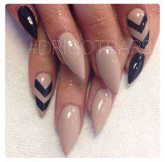 Nude stiletto nails with black chevron designs