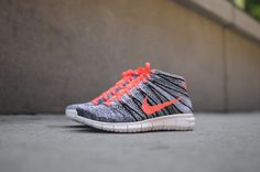 Nike WMNS Free Flyknit Chukka mango / black / white on Trends Periodical