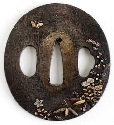 Tsuba with flowers and a butterfly.