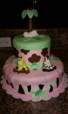 Baby girl shower cake but with 2 giraffes & 2 babies in pink diapers for twins!