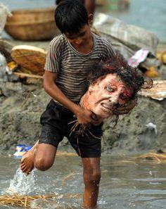 A child carrying the head of demon Mahisasura