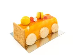 Exotic Log (GF): Passion fruit/Pineapple mousse, pink guava/banana jelly, vanilla bean rice pudding & coconut almond cake