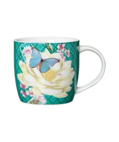 Looking for a perfect gift item to represent your love and care? Get hands on this #marvelous accessorize #mug that has beautiful design pattern and it serves as a regularly used item. It has a green flower engraved throughout its structure.