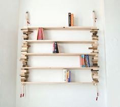 A bookshelf like this would fit perfectly above my couch