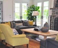 Home Interior Is Decorated With 8 Picture Which Are Arranged In Yellow And  Gray Living Room