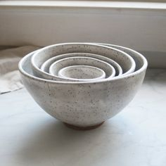 This five bowl nesting set was hand thrown and trimmed on my pottery wheel using a white stoneware clay. Each bowl was bisque fired and glazed with...