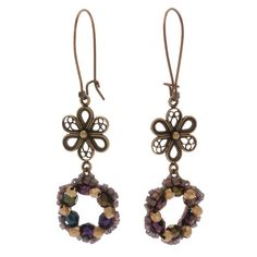 A quick and easy bead weaving project is the focal point of these pretty earrings. The flower shaped wreath compliments the flower themed ornate brass filigree connector link well and provides an elegant and