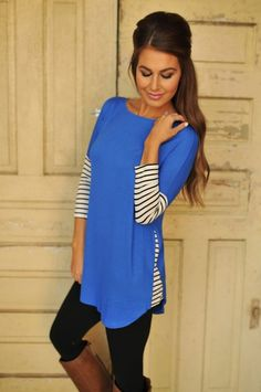 Lovely blue tunic with striped sleeves. Perfect combination with leggings and long boots