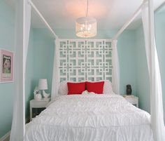 Love this geometric head board idea... White and the light blue is a great color combo with the pop of red-orange from the pillows