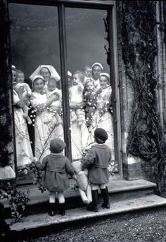 London orphanage, they look like they're window shopping for a baby brother or sister. Writing prompt?