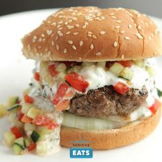 Big burgers with a creamy yogurt-feta sauce flavored with garlic and lemon, topped with a crunchy cucumber-tomato relish.