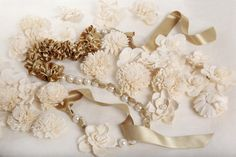 Champagne colored ribbon, fabric flower appliques, and pearl beads (via Midori)