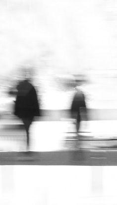 Blurred Figures Under Umbrellas