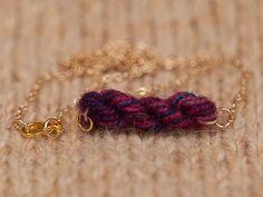 Purple Berries Skein of Yarn Necklace, via Etsy.