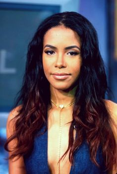 Aaliyah. She was before her time. Still looks up to date in 2013. I can't believe she's been gone for 12 years.