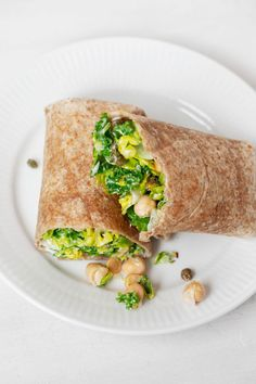 There's no more convenient way to incorporate more beans and greens into your diet than these tasty vegan chickpea Caesar wraps! They're made with nutritious garbanzo beans and chopped romaine lettuce, mixed together with a dairy-free Caesar dressing. #vegan #wfpb #plantbased
