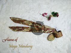 Flame Mega Mendung Twilly  Mega mendung is a well-known pattern comes from Cirebon(west Java), mega mendung with orange and red color combination gives you vitality impression
