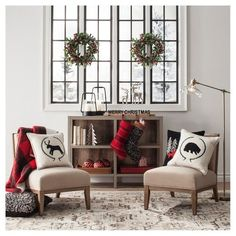 If the cabin sounds like your favorite winter retreat, you'll love the Cozy Winter Living Room Corner Collection's rustic flair and heritage-inspired pieces. Classic wreaths and reindeer figurines cue holidy nostalgia, while needlepoint pillows and red plaid make for warm winter decor all season.