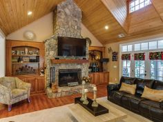 Great room, stone fireplace and plenty of big windows looking out at Lake Norman.