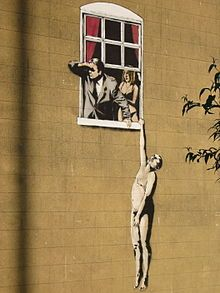 Banksy - Window Lovers, Sexual Health Clinic for Young People, Bristol 2006.    When a survey was sent out to Bristol residents to ask whether or not they wanted the graffiti to stay or be removed, an overwhelming 97% voted for it to stay!