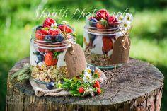 Fruits granola and yogurt in countryside