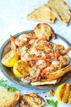 Grilled Garlic Butter Shrimp - The lemon garlic butter sauce is simply perfect! Pair with a glass of wine and crusty bread for the best 30 min meal ever!