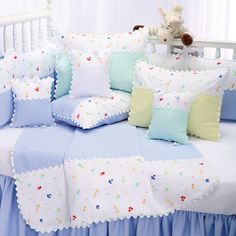 """Adorable baby zoo animals prance upon our colorful, all cotton """"Little Zoo"""" #babybedding. Edged with white 'Ric Rac' in your choice of pastel periwinkle blue, mint green, yellow, or classic white. #thebabysweet #cribbedding #babygirlnursery #babyboynursery #nurserybedding #luxurybabybedding"""
