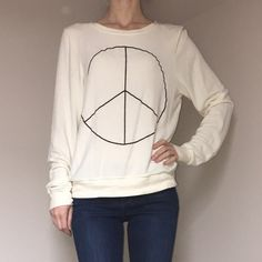 Wildfox Baggy Beach Jumper Super soft and comfy, Wildfox sweaters are perfect for staying in or going out. This peace sign has some extra bling in black glitter. Wildfox Sweaters Crew & Scoop Necks