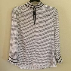 J. Crew High Neck Sheer Blouse J. Crew cream and black long sleeve blouse. High neck with ruffled collar and two button keyhole. Black grosgrain ribbon trim around neck and cuffs. Good used condition. J. Crew Tops Blouses