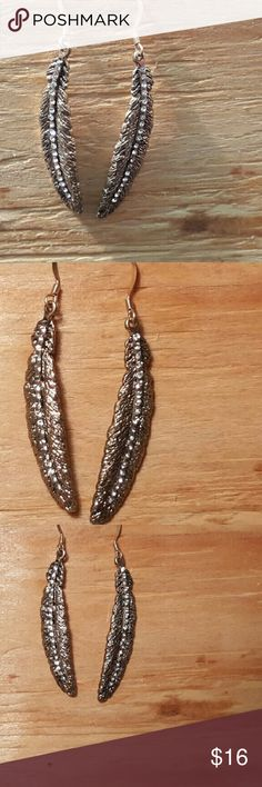 Goldtone and Rhinestone Feather Dangle Earrings 2 inch long, 1/2 inch wide, with earring wire gives a full 2 1/2 inch drop. Cute with jeans or dress up for night on the town. Life by Design  Jewelry Earrings