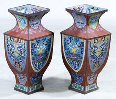 Lot 567: Asian Cloisonne Vases; Pair of contemporary square shaped vases having stylized eyes