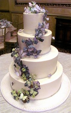 Cascade of Butterflies Wedding Cake - Elegant winding cluster of hand painted butterflies floats toward the sky in soft greens, lavender and purples.