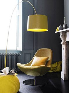 Love that yellow lamp, gray room, white trim.