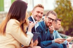 Cheerful business team talking outdoor stock photo